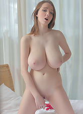 nubile sex, 18yo hottie with 70H (32G) breasts relaxing in bed