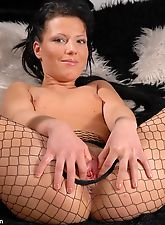 Celine's ready to get us all in the mood as she rolls around in bed teasing us! Nothing is hotter than black fishnets with easy access right?