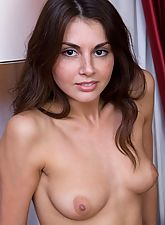 young nubiles, Curly small tits brunette posing naked on the couch